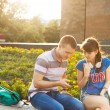 Two students or teenagers with mobile phone outdoors — Stock Photo #50264583