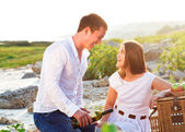 Happy couple in love at the summer picnic — Stock Photo