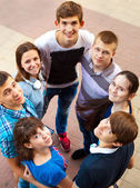 Group of smiling teenagers standing outdoors — Stock Photo