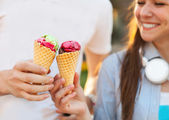 Cute young beautiful teen couple in city near university with ic — Stock Photo