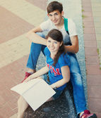 Two students or teenagers with notebooks outdoors  — Stock Photo