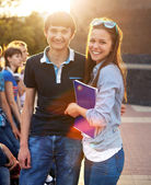 Group of students or teenagers with notebooks  — Stock Photo