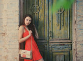 Cute girl near the old wooden door — Stock Photo