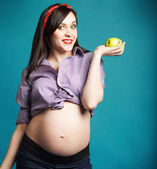 Happy young funny pregnant woman in pin up style — Stock Photo