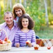 Happy young family on autumn picnic — Stock Photo #51047801