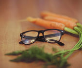 Glasses next to a carrot  — Stock Photo