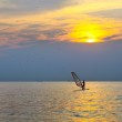Windsurfer silhouette over sea sunset — Stock Photo #51401013