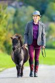 Woman with pony — Stock Photo
