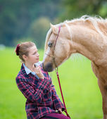 Woman with horse — Stock Photo