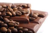 Macro shot of chocolate and coffee beans — Stock Photo