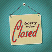 Vintage sign with words sorry we're closed — Stockvector