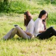 Twogirls with books outdoor — Stock Photo