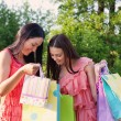 Two girls with colored bags outdoor — Stock Photo #12583144