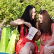 Two girls with colored bags outdoor — ストック写真