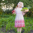 Little girl in the garden — Stock Photo