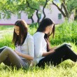 Two girls with books in park — ストック写真