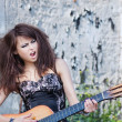 Model with vintage guitar. — Stock Photo