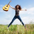 Stock Photo: Beautiful girl with guitar outdoor