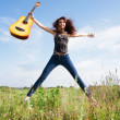 Beautiful girl with guitar outdoor — Stock Photo