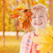 Stock Photo: Girl in the autumn forest