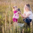 Mother, daughter and the kitten — Stock Photo #12588327