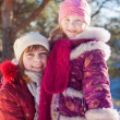Two teenage sisters girl outdoors winter smiling portrait — Stock Photo