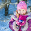 Girl with a Christmas toy in hands — Stock Photo
