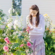 Stock Photo: Woman Planting In a Garden