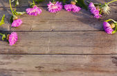 Cornflowers on wooden background — Stock Photo