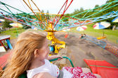 Little girl having fun in a carousel — Stock Photo