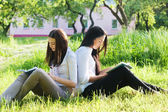 Two girls with books in park — Stock Photo
