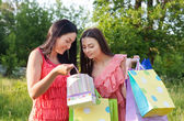 Two girls with colored bags outdoor — Стоковое фото