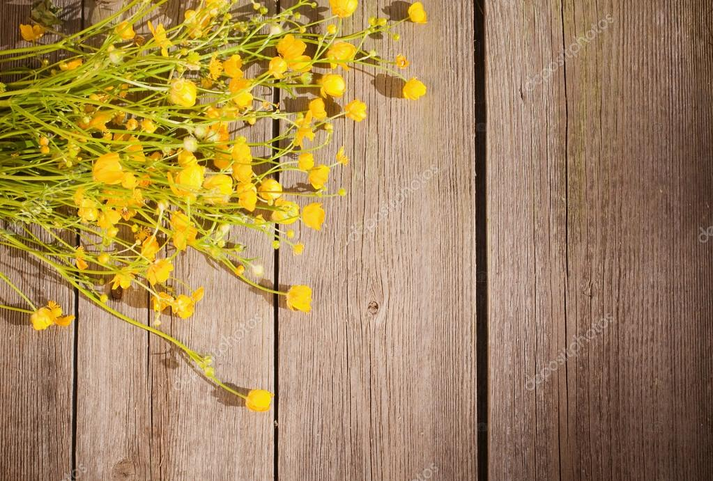 Yellow flowers on wooden background — Stock Photo #12583932