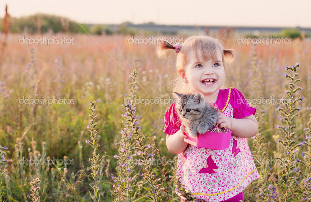 Girl and kitten  Stock Photo #12588470