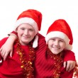 Children in red christmas hats — Foto de Stock   #1303527