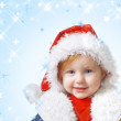 Child in red christmas hats — Stock Photo #1309117