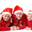 Children in red christmas hats — Stock Photo #1309390