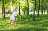 Beautiful young woman doing stretching exercise — Stock Photo