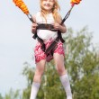 Happy girl jumping in amusement park — Stockfoto
