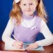 Schoolgirl on the table — Stock Photo