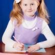 Schoolgirl on the table — Stock Photo #18612297