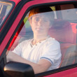 Young man sitting in the car — Stock Photo