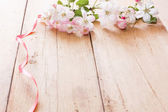 Spring flowers on wooden background — Foto Stock
