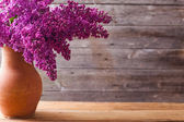 The beautiful lilac on a wooden background — Stock Photo