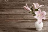 Vintage flowers on wooden background — Stock Photo