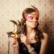 Stock Photo: Beautiful girl in mask