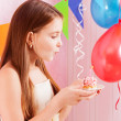 Girl with birthday cake - Stock Photo