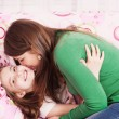 Ill girl with her mother — Stock Photo