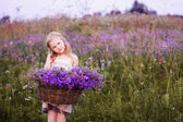 Beautiful girl with flowers outdoor — Stock Photo