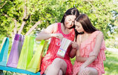 Two girls with colored bags outdoor — Stock Photo